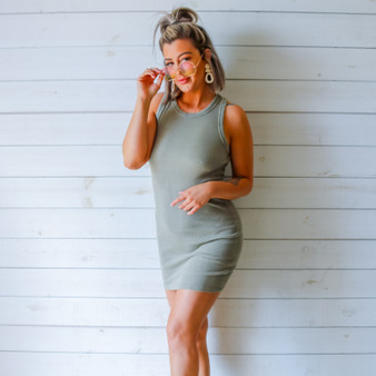 -Olive Color -Acid Wash Detail at Neckline -Racerback -Ribbed -Fabric Stretches  -Mini Dress  Materials: 95% Cotton   5% Spandex  DZ21F055 DRESS OLV