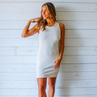 -Ivory Color -Acid Wash Detail at Neckline -Racerback -Ribbed -Fabric Stretches  -Mini Dress  Materials: 95% Cotton | 5% Spandex  DZ21F055 DRESS WHT