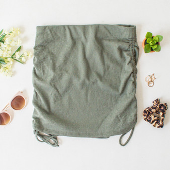 -Olive Color -Side Ruching -Adjustable Ties -Ribbed -Elastic Waistbands -Ribbed -Comes in 3 Colors -Mini Skirt  Materials: 80% Polyester | 13% Rayon | 7% Spandex  WS8074 SKIRT OLV
