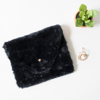 -Black Color -Fuzzy Material -Gold Button Closure -Pleather Material  -Lined -Strap is Removable to be Used As Clutch -Gold Chain Strap -Bag  0521 CCBAG 20