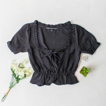 -Black Color -Ruffle Neckline -Ties in Front -Short Sleeve -Peplum Hem -Top  Materials: 80% Rayon | 20% Nylon  HF21E640 TOP BLK