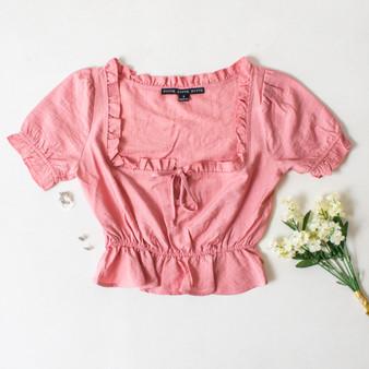 -Pink Color -Ruffle Neckline -Ties in Front -Short Sleeve -Peplum Hem -Top  Materials: 80% Rayon | 20% Nylon  HF21E640 TOP PNK