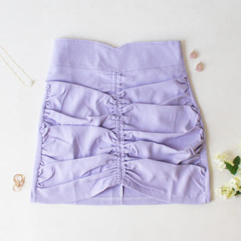 -Lilac Color -Ruched on Front -Zipper Closure in Back -V-Cut Detail in Front -Lined with Shorts -Mini Skirt  Materials: 80% Polyester | 20% Cotton  CS5291 SKIRT PRP