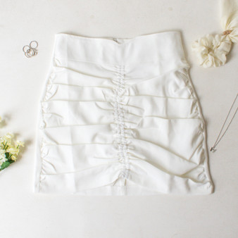 -White Color -Ruched on Front -Zipper Closure in Back -V-Cut Detail in Front -Lined with Shorts -Mini Skirt  Materials: 80% Polyester | 20% Cotton  CS5291 SKIRT WHT