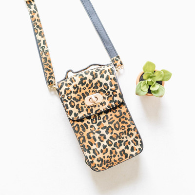 - Leopard Print - Textured Feel - Clasp Closureb - Detachable Straps  - Back Pocket
