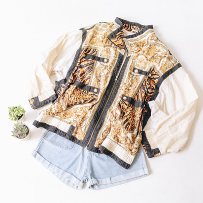 """- Collar - Long Sleeves  - Black and Cream with Orange Floral Detail  - Tiger Print Detail  - Pearl Embellishment  - Color Blocking Detail  - Zipper Closure  - Has Pockets  - Cinched Waistband   Top is a size 2XL   Clothing Measurements: Bust: 29"""" Length: 28"""" Sleeve Length: 22"""""""