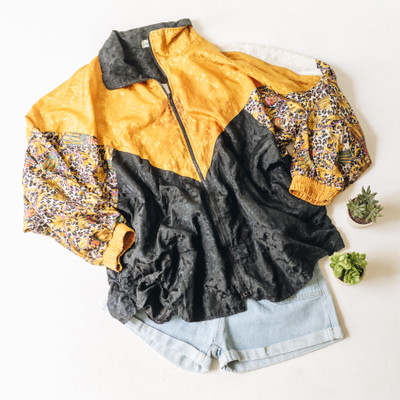 "- Collar - Long Sleeves  - Orange and Black with Tassel Print on the Sleeves  - Color Blocking Detail  - Zipper Closure  - Has Pockets   Top is a size X-Large   Clothing Measurements: Bust: 30"" Length: 30"" Sleeve Length: 22"""