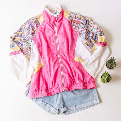 """- Collar - Long Sleeves  - Pink and Yellow with Print Design on Sleeves  - Color Blocking Detail  - Zipper Closure  - Has Pockets   Top is a size Large   Clothing Measurements: Bust: 26"""" Length: 27"""" Sleeve Length: 23"""""""