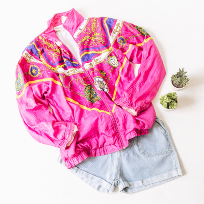 """- Collar - Long Sleeves  - Purple with Gold Locket Print  - Zipper Closure  - Has Pockets   Top is a size Large   Clothing Measurements: Bust: 23"""" Length: 28"""" Sleeve Length: 25"""""""
