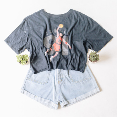 """- Crew Neck  - Short Sleeves  - Black Tee  - Jordan Design  - Design is on the Front  - Cropped   Top is a size X-Large   Clothing Measurements: Bust: 24"""" Length: 20"""" Sleeve Length: 9"""""""