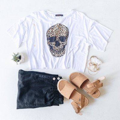 - White Tee  - Crew Neck  - Short Sleeves  - Cropped  - Raw Hem Line  - Cheetah Skull Design  - Design is on the Front  - Fabric Does Stretch   Model is Wearing a Size Small  Material Content: 95% Rayon  5% Spandex   JP113 TEE