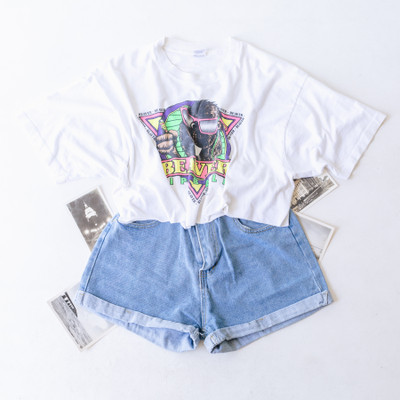 """- Crew Neck  - Short Sleeves  - White Tee - Beaver Lip Balm Design  - Design is on the Front and Back   - Cropped   Top is a size X-Large   Clothing Measurements: Bust: 22.5"""" Length: 15"""" Sleeve Length: 8"""""""