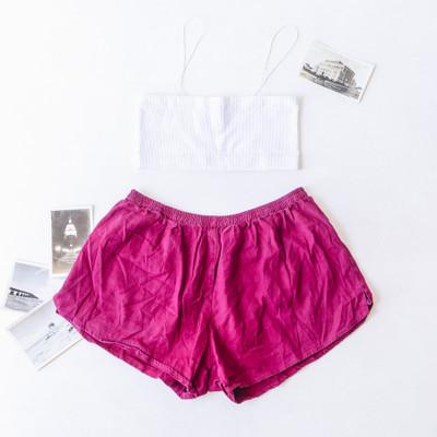 "- Purple  - Elastic Waist Band  - Shorts  - Light Denim Material  - Running Short Style/Cut   Bottom is a size Medium   Clothing Measurements: Waist: 16"" Length: 13"""
