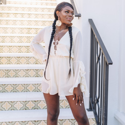 - Comes In Two Colors   - Ruffle Sleeves - Ruffle Trim - Lace-up V-neck - Lined - Elastic Band Around Waist - Fabric Does Not Stretch  Model is Wearing a Small  Material Contents: 100% Polyester  FL20F405 ROMP