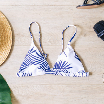 - White - Blue Palm Print  - Triangle  - Clasp Closure   - Removable Padding  Material Content: 82% Polyester 18% Spandex  SWIM TOP BPALM