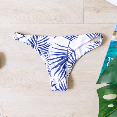 - White - Blue Palm Print  - Low Rise   Material Content: 82% Polyester 18% Spandex  SWIM BOT BPALM