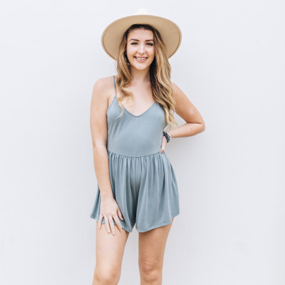 - Comes In Six Colors  - Solid Color - Spaghetti Straps - Criss-cross Straps   - Straps are Adjustable  - Elastic Waist Band   - Fabric Does Stretch  Model is Wearing a Size Small  Material Content: 65% Modal 35% Polyester     DZ20E344 ROMP