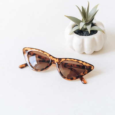 - Comes In Two Colors - Cateye Style - Tortoiseshell Detail - Medium Lens