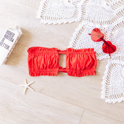 - Red - Bandeau   - Scrunch Detail  - Ties in Back  Model is wearing a Small   SWIM TOP RED