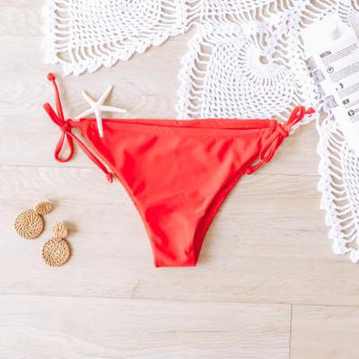 - Red - Tie Side  - Scrunch Detail    Model is wearing a Small   SWIM BOT RED