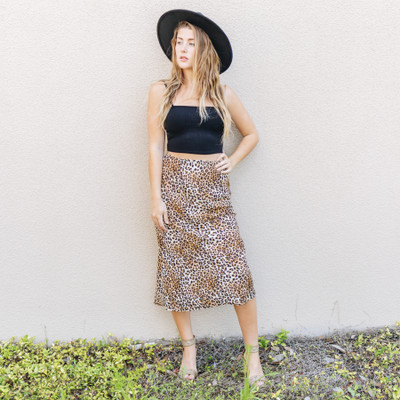 -Cheetah Print  -Mid Length  -Unlined  -High-Waisted  -Runs Small     Model is Wearing Size Medium   Material:  100% Polyester     S11568 SKIRT CHTA