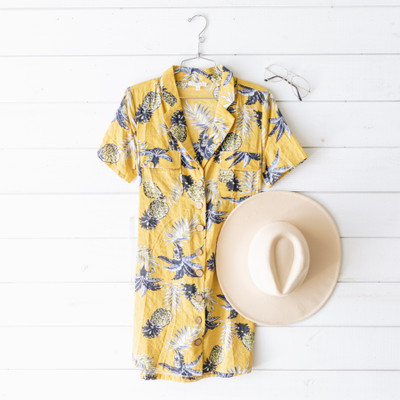 -Yellow-Green Fabric  -Yellow and Navy Pineapple Print  -Collared Neckline  -Button Up Detail in Front  -Tie Waist  -Unlined    Model is Wearing Size Small     Material:  60% Cotton  40% Rayon     D3423 DRESS YELF