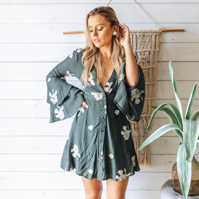 - Green  - Boho  - Bell Sleeves  - Embroidered Floral Print  - Buttons  - Lined     Model is Wearing Size Small     Material:  75% Cotton  25% Nylon     DKA1307 DRESS TEALF