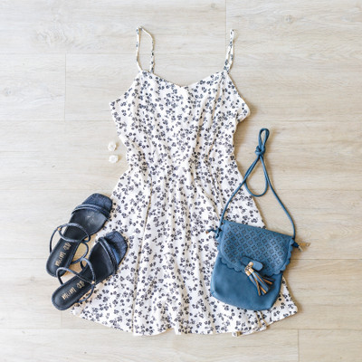 -Ivory -Black Floral Print -Spaghetti Straps -Adjustable Straps -Sundress -Zipper -Tie -Lined -Comes in 2 Colors  Model is Wearing Size Small  Material: 100% Rayon/100% Polyester  D11109 DRESS WHTF