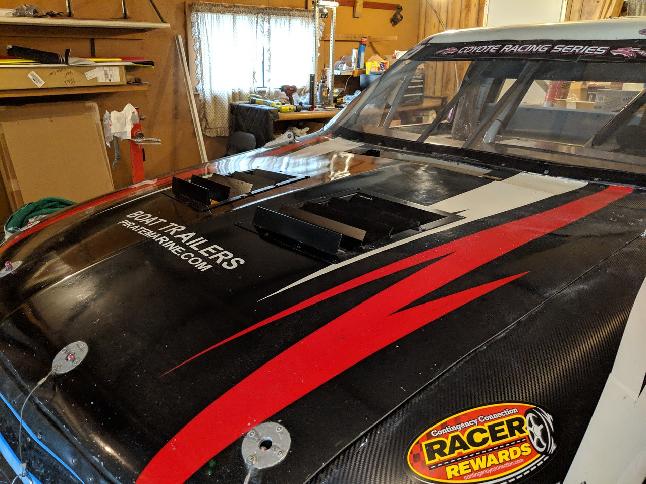 Race Louvers RX trim straight angular pair racing heat extractor installed on a circle track truck series race car.