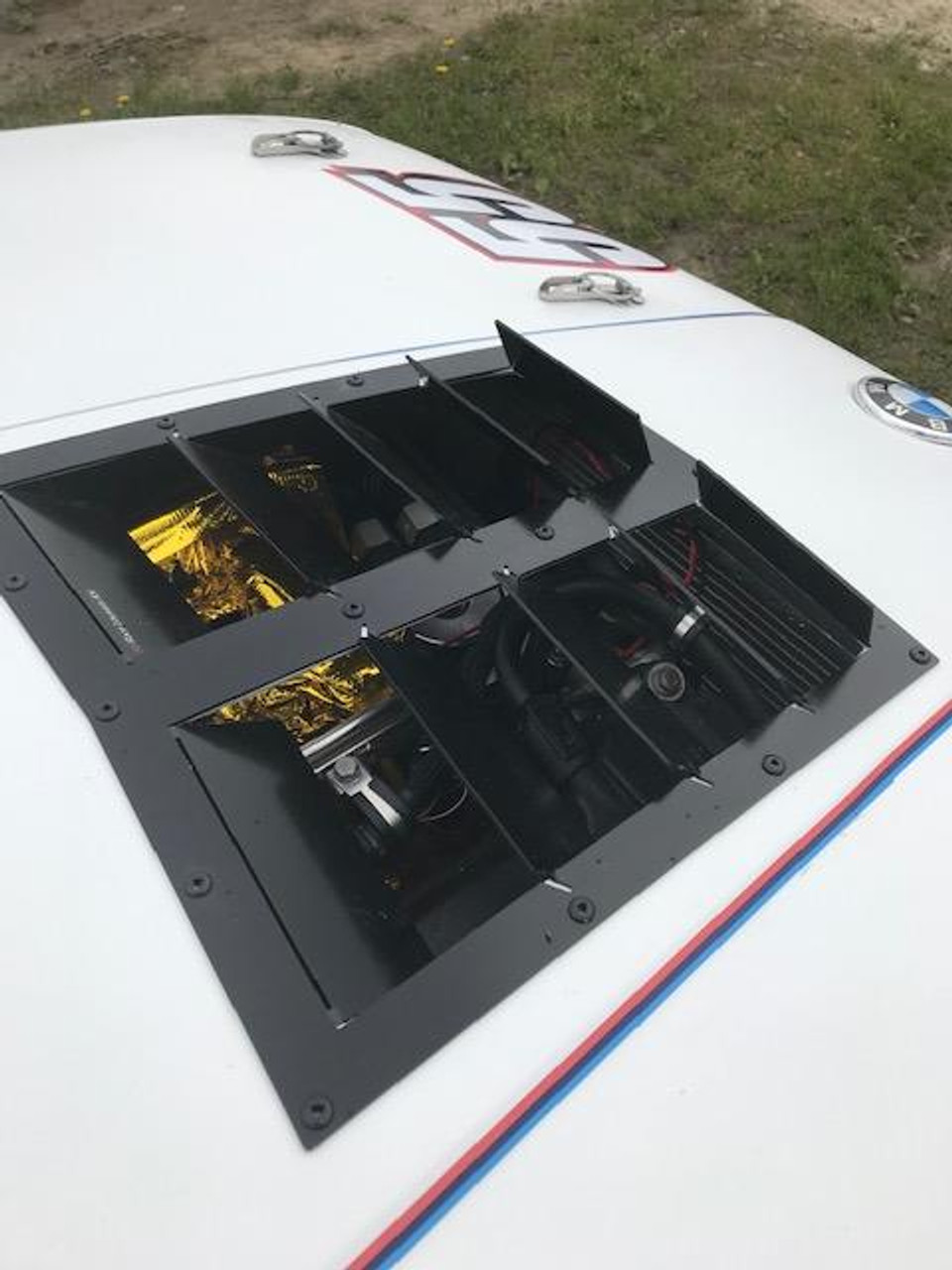 Race Louver BMW E30 RT Track Trim center car hood extractor is designed for street, high performance driving and track duty.