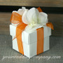 White Wedding Favor Box with Orange Ribbon and Hydrangea Petals