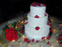 Burgundy Rose Petals on a White Wedding Cake