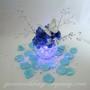Aqua Blue Rose Petals Surrounding a Wedding Centerpiece