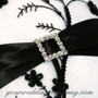 Black and White Embroidered Ring Pillow with a Rhinestone Buckle