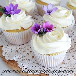Wedding Cupcakes with Purple Flowers on a Doily