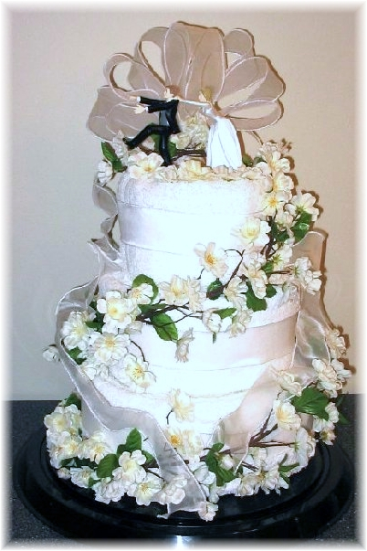 White and Silver Towel Cake