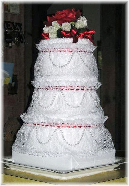 White and Red Towel Cake