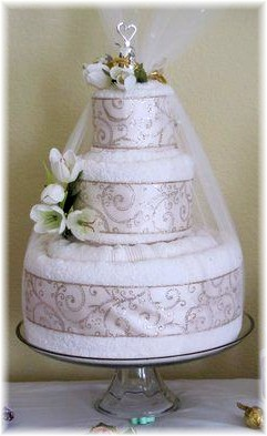 White Towel Cake with Silver Ribbon