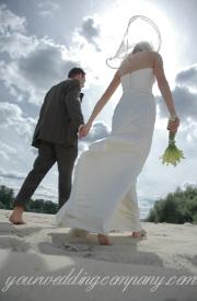 Destination wedding couple on the beach.
