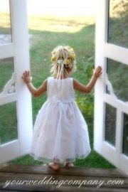 Flower girl in a white dress.