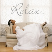 Relaxed bride on tan couch.