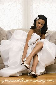Beautiful bride sitting on a couch.