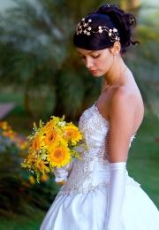 Beautiful bride holding a yellow wedding bouquet.