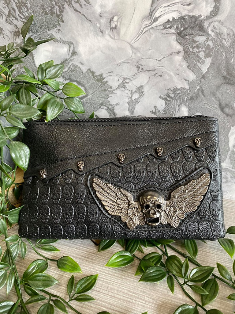 Skull Embossed Clutch Handbag with Winged Skull Embellishment