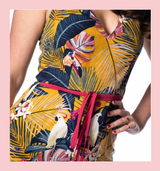Banned Apparel Mustard Yellow Tropical Toucan and Palm Leaf Print V Neck Sleeveless Jumpsuit at Cerys' Closet