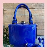 Royal Blue Patent Cylinder Shaped Handbag with Art Deco Clasp Double Handles and Detachable Shoulder Strap at Cerys' Closet