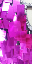 A short handmade sequin dress, in rectangular metallic fuchsia paillette sequins with silver faceted beads with close up view