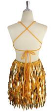 A short handmade sequin dress, in diamond-shaped metallic gold sequins back view