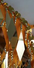 A short handmade sequin dress, in diamond-shaped metallic gold sequins close up view