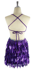 A short handmade sequin dress, with diamond-shaped metallic silver and purple sequins back view